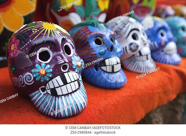 Colorful skulls for sale at the stalls in Chichen Itza Archaeological Site, Yucatan Province, Mexico, Central America