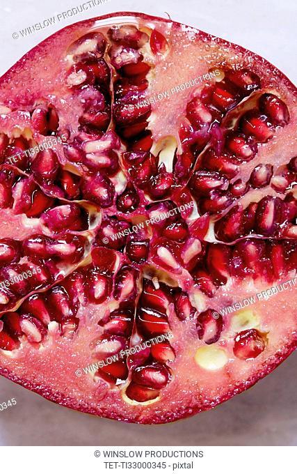 Halved Pomegranate against white background