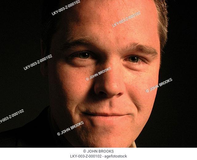 Closeup of man's grinning face