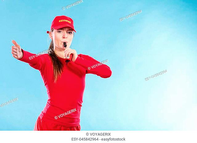 e397b612735 Lifeguard woman girl in red cap on duty supervising swimming pool water  blowing whistle on blue