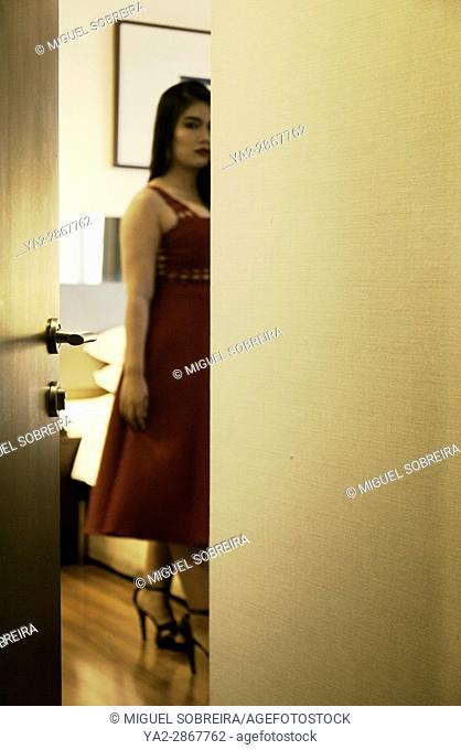 Blurred Glimpse of Woman in Hotel Room