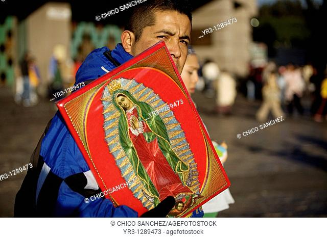 A pilgrim carries an image of the Our Lady of Guadalupe outside of the Our Lady of Guadalupe Basilica in Mexico City, December 9