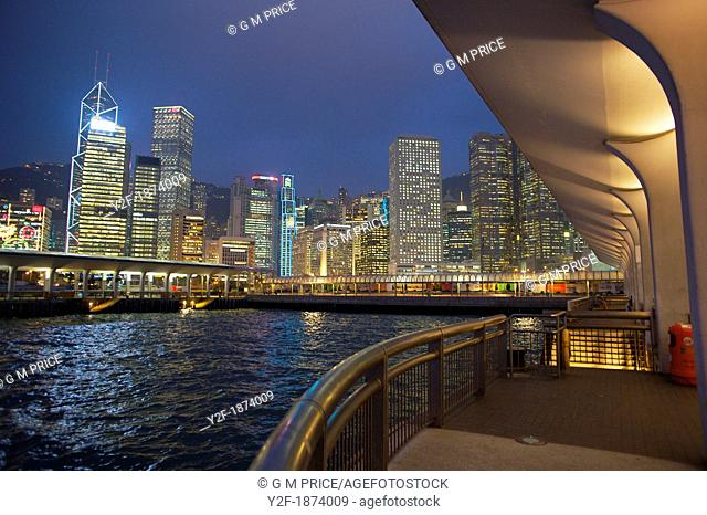 Central district Hong Kong skyline at night, seen from ferry pier