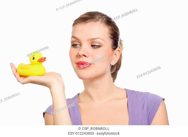 woman with a yellow rubber duck on her hand