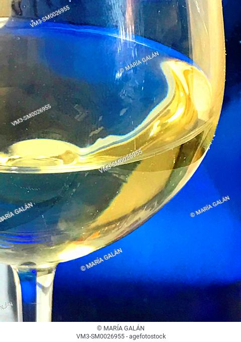 Glass of white wine. Close view
