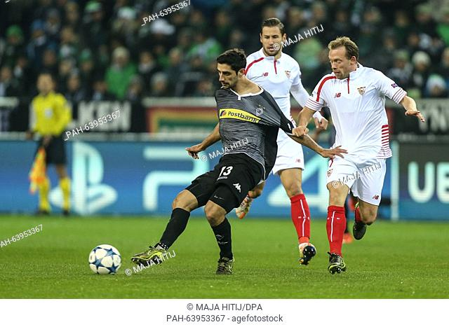Sevilla's Michael Krohn-Dehli (R) and Moenchengladbach's Lars Stindl vie for the ball during the Champions League soccer match between Borussia Moenchengladbach...