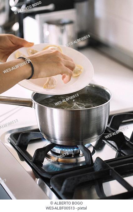 Homemade ravioli, cooking pot