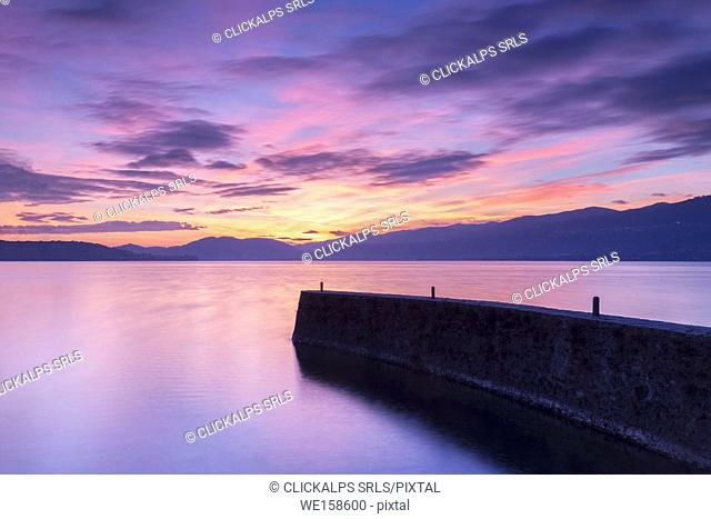 Sunset at the old pier, Lake Maggiore, Ispra, Varese Province, Lombardy, Italy