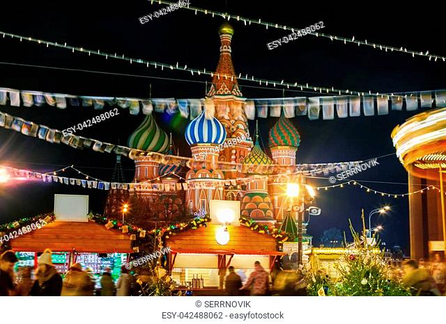 Festive Christmas fair at the Red Square against the Saint Basil's Cathedral in Moscow