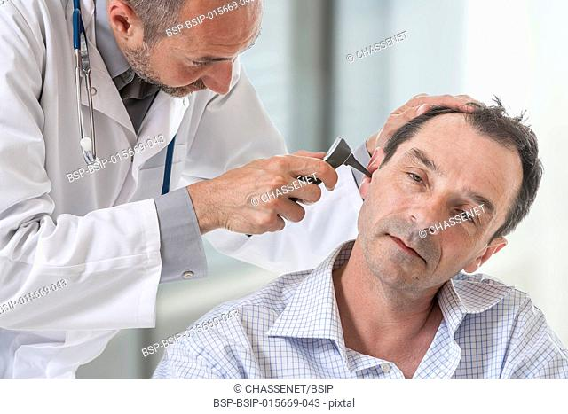 Doctor examining a patient's ear