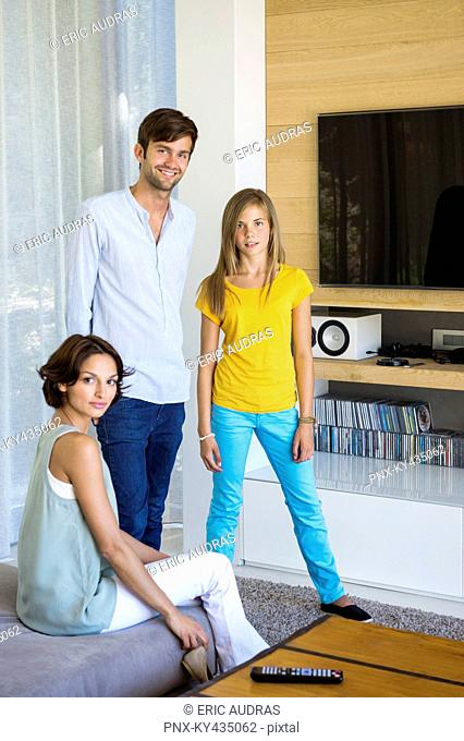 Couple with their daughter in a living room