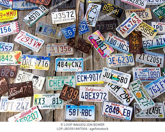 American car registration plates on display at a Bar Harbour restaurant in Maine