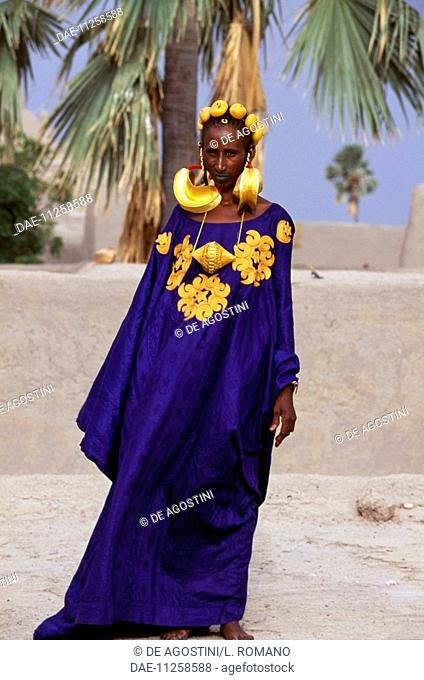 Fulani woman from a wealthy Marabout family, wearing clothes and jewelry for a wedding, village near Mopti, Mali
