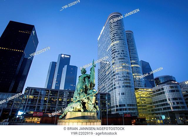 La Défense de Paris - memorial statue with the modern buildings of La Defense district, Paris France