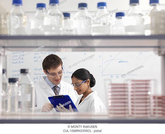 Laboratory technicians with clipboard