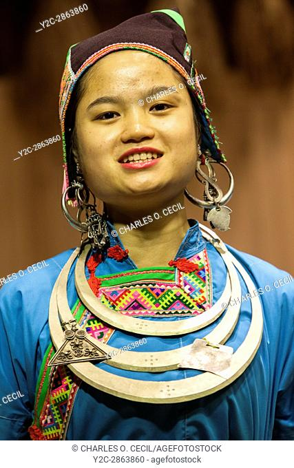 Zhaoxing, Guizhou, China. Young Woman of the Dong Ethnic Minority in a Traditional Music Performance