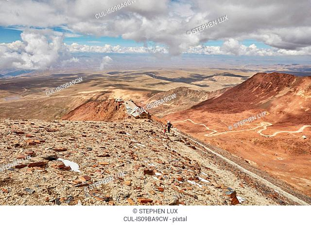 Mother and son, trekking across landscape, Chacaltaya, La Paz, Bolivia, South America