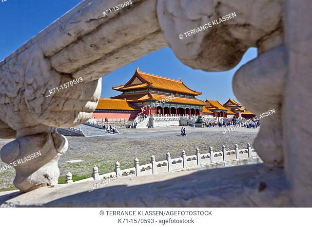 The architecture of the Forbidden City through a window in Beijing, China, Asia