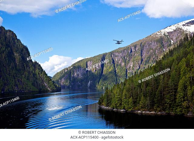 Floatplane carrying sightseers over the Behm Canal that cuts through the Misty Fjord National Monument, Alaska, U.S.A