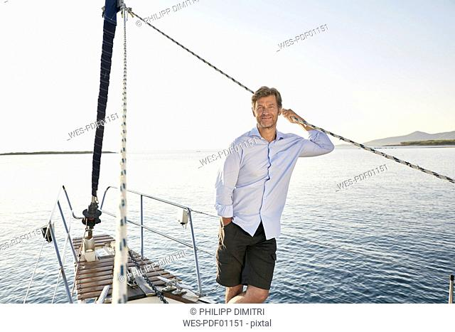 Portrait of realxed mature man on his sailing boat