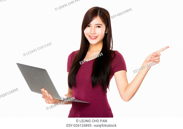 Young Woman use of the laptop computer and finger point up