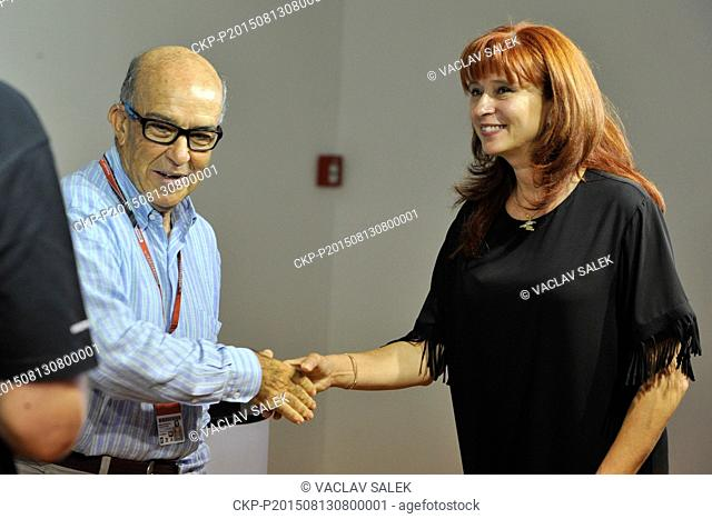 From left CEO of Dorna Carmelo Ezpeleta and director of Brno Circuit CEO Ivana Ulmanova shake hands during the press conference prior to the Grand Prix of Czech...