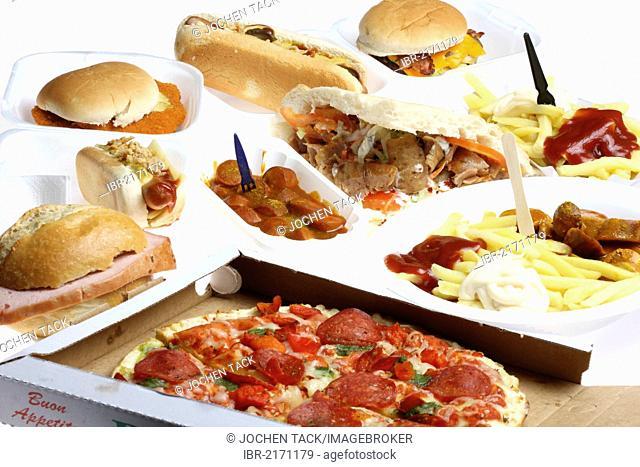 Various fast food meals, hamburgers, sausages, french fries, pizza, doner kebab, hot dog