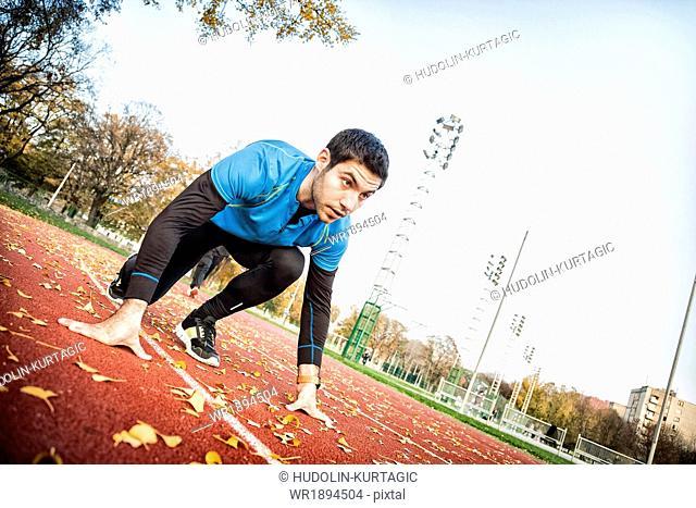 Male runner doing sprint training