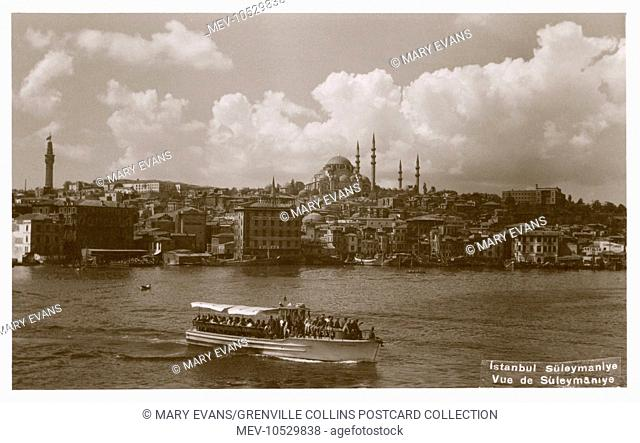 A view across the waters of the Bosphorus toward the striking profile of the dome and minarets of the Suleimaniye Mosque at Constantinople, Turkey