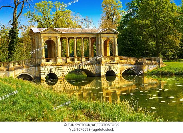 The Palladian Bridge 1774 designed by James Gibbs over the lake in the English landscape gardens of Stowe, designed by Capability Brown  Buckingham, England