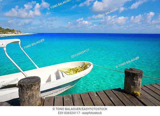 Riviera Maya wood pier and boats in Mayan Mexico