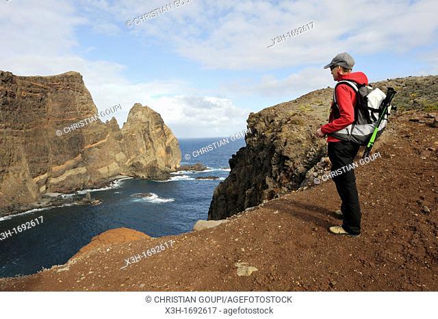 young woman walking on Cevada islet, Sao Lourenco peninsula, Madeira island, Atlantic Ocean, Portugal
