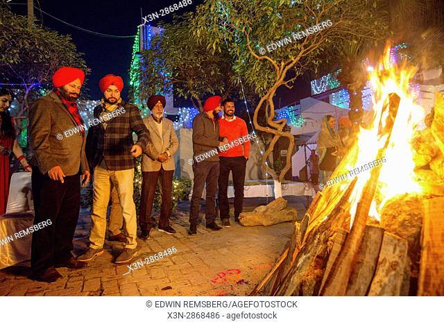 Guests gather around the bonfire at the Lohri celebration in Punjab, India