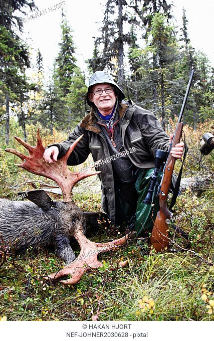Hunter with killed elk