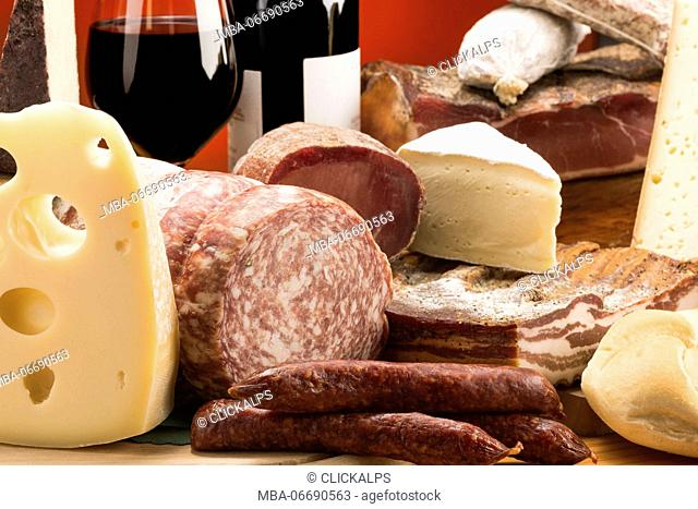 Still life, mixed salami, Mixed cheeses, typical products, red wine, Salami and cheeses, Trentino, AltoAdige, Dolomites, food