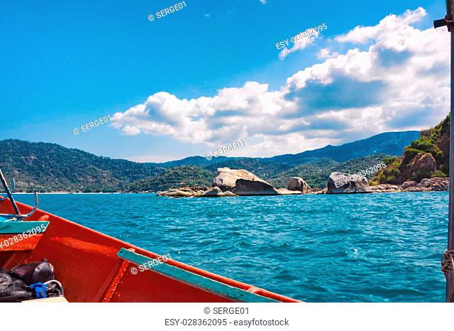 Tropical island shore in the Gulf of Thailand. View from boat