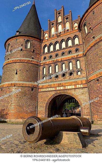Holstentor and historic gun, Lübeck, Schleswig-Holstein, Germany