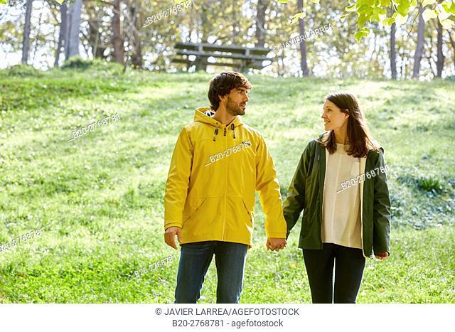 Couple walking in the forest, Pagoetako Parke Naturala, Pagoeta Natural Park, Aya, Gipuzkoa, Basque Country, Spain