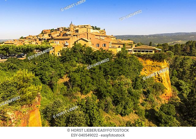 View of Roussillon with ocher cliffs. Vaucluse, Provence, France