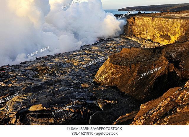 Steam rising off lava flowing into ocean at sunrise, Kilauea Volcano, Big Island, Hawaii Islands, USA