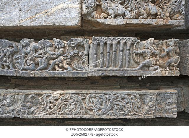 Episode from Ramayana. Rama shooting arrow at Bali through seven trees. Kedareshwara temple, Halebidu, Karnataka, india. carved on the Friezes at the base of...