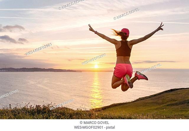 Female athlete jumping for joy