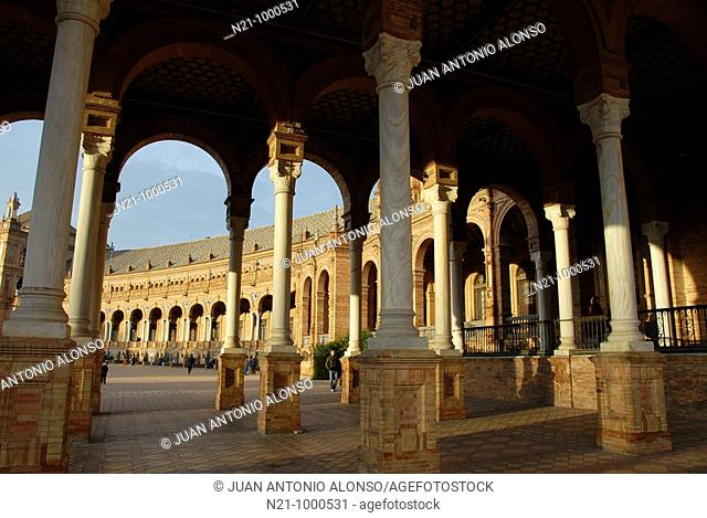 Arched galleries of a neo-renaissance palace in the shape of a semi-circular theatre. Plaza de España. It is located in the María Luisa Park and the square and...