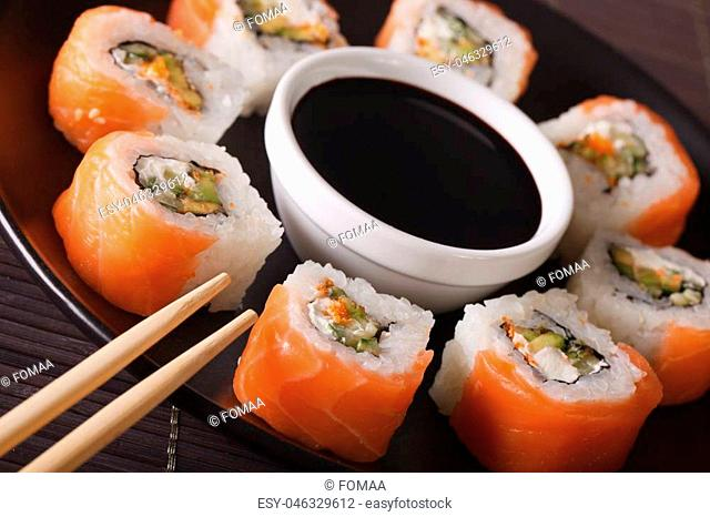 Philadelphia rolls with fresh salmon close-up on a plate. horizontal