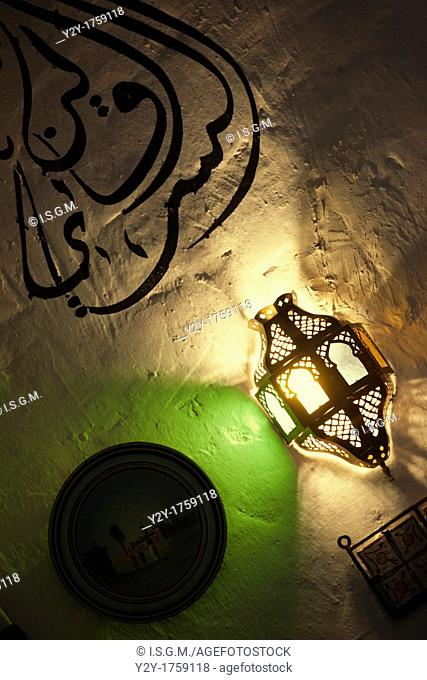 Decorative lamp and words in an Moroccan restaurant in Valencia, Spain