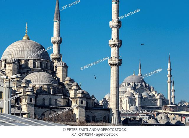 The Yeni mosque at Eminonu with the Suleymaniye mosque in the background. Istanbul, Turkey
