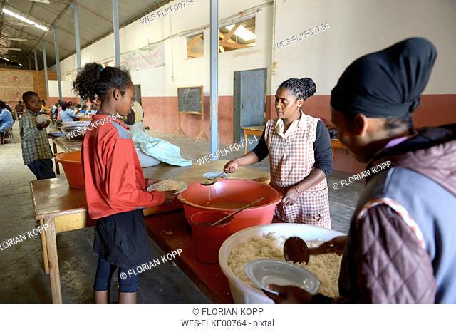 Madagascar, Fianarantsoa, Children getting food in school refectory