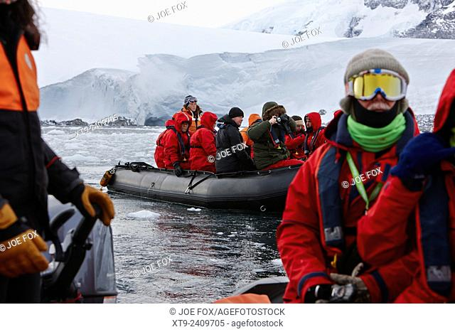groups of tourists on zodiac excursion port lockroy antarctica