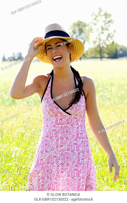 Woman standing in a field and laughing