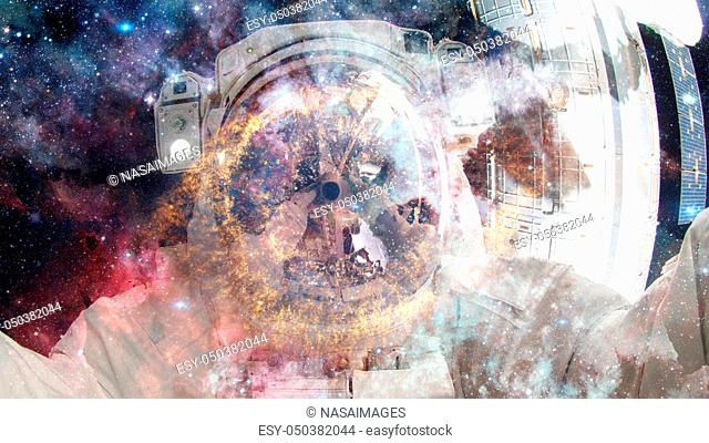Astronaut in outer space. Science fiction art. Elements of this image furnished by NASA